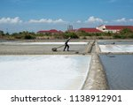 worker at salt marshes in can...   Shutterstock . vector #1138912901