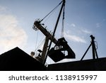 silhouette of cranes when... | Shutterstock . vector #1138915997