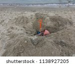 children dig a hole in the sand ... | Shutterstock . vector #1138927205