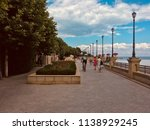 people stroll along the... | Shutterstock . vector #1138929245