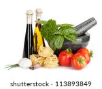 Italian food: pasta, tomatoes, fresh herbs in mortar, olive oil, vinegar. Isolated on white background - stock photo