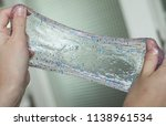 glitter slime being stretched...   Shutterstock . vector #1138961534