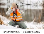 male hunter in camouflage ... | Shutterstock . vector #1138962287