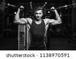 handsome young fit muscular... | Shutterstock . vector #1138970591
