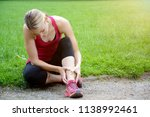 sporty young woman has pain in... | Shutterstock . vector #1138992461