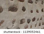 large stones in concrete... | Shutterstock . vector #1139052461