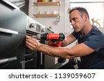 man building kitchen and using...   Shutterstock . vector #1139059607