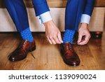 elegant man dresses shoes. two... | Shutterstock . vector #1139090024