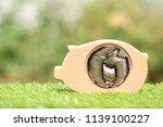 stack of coins money in piggy...   Shutterstock . vector #1139100227