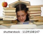 girl schoolgirl asleep with... | Shutterstock . vector #1139108147