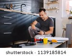 man working on a new kitchen... | Shutterstock . vector #1139185814