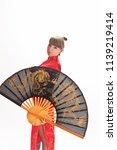 girl in red kimano in big fan | Shutterstock . vector #1139219414