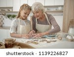 kind granny is teaching her... | Shutterstock . vector #1139226827