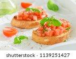 fresh and tasty bruschetta with ... | Shutterstock . vector #1139251427