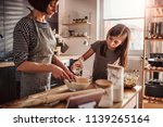 mother and daughter making... | Shutterstock . vector #1139265164