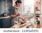 woman wearing grey apron making ... | Shutterstock . vector #1139265251