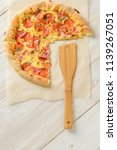 pizza cheese board on a wooden... | Shutterstock . vector #1139267051