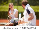 tennis trainer with girl player ... | Shutterstock . vector #1139267204
