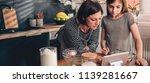 mother and daughter standing in ... | Shutterstock . vector #1139281667
