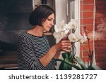 woman standing in the kitchen... | Shutterstock . vector #1139281727