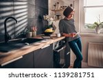 woman standing in the kitchen... | Shutterstock . vector #1139281751