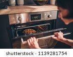 woman standing by the oven and... | Shutterstock . vector #1139281754