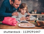 girl sitting by the table at... | Shutterstock . vector #1139291447