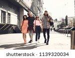full length portrait of glad... | Shutterstock . vector #1139320034