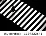 a man walking across zebra... | Shutterstock . vector #1139322641