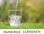 closeup of pouring pure water... | Shutterstock . vector #1139325374