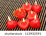 Red candles on wooden math. - stock photo