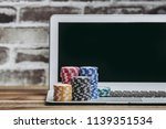 casino coins and laptop | Shutterstock . vector #1139351534