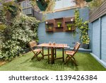 back yard with outdoor seating... | Shutterstock . vector #1139426384