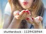 beauty young woman blowing... | Shutterstock . vector #1139428964