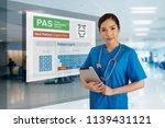 female doctor in blue uniform... | Shutterstock . vector #1139431121