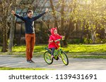father teaching his daughter to ... | Shutterstock . vector #1139431691