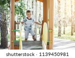 boy in a blue t shirt and... | Shutterstock . vector #1139450981