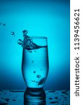 splash of water in a glass on a ... | Shutterstock . vector #1139456621