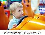 cute blond little boy driving... | Shutterstock . vector #1139459777