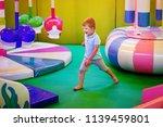 cute little boy in a blue t... | Shutterstock . vector #1139459801