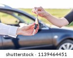 one woman hands over another... | Shutterstock . vector #1139464451