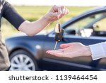one woman hands over another... | Shutterstock . vector #1139464454