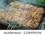 preparation of a shish kebab... | Shutterstock . vector #1139499194