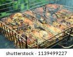 preparation of a shish kebab... | Shutterstock . vector #1139499227