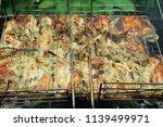 preparation of a shish kebab... | Shutterstock . vector #1139499971