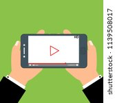 smartphone with video player on ...