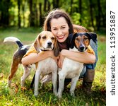 Stock photo beautiful woman and his dogs posing outside 113951887