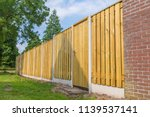 new wooden fence construction... | Shutterstock . vector #1139537141
