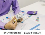 Businessmen are calculating and ...