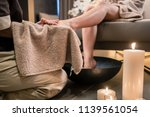 asian therapist wiping the feet ... | Shutterstock . vector #1139561054